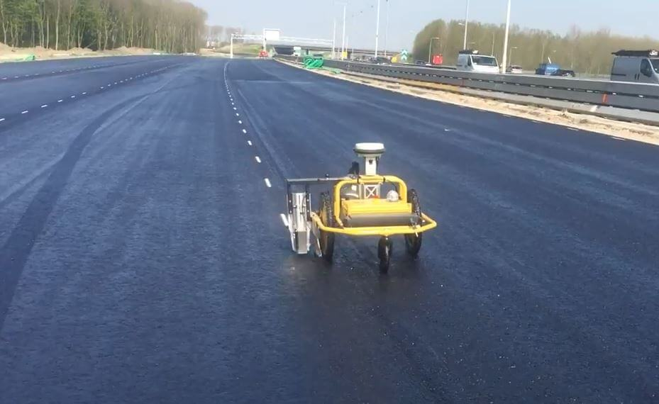 Autonomous premarking robot TinyPreMarker setting out premarkings in road construction