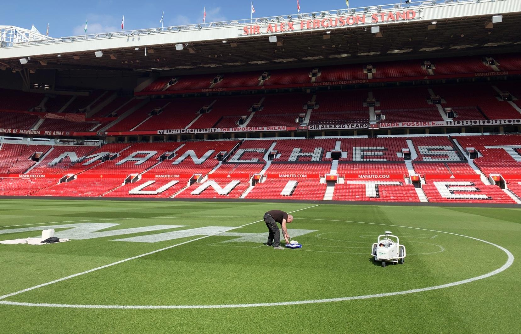 Logo marking Manchester United NHS Old Trafford