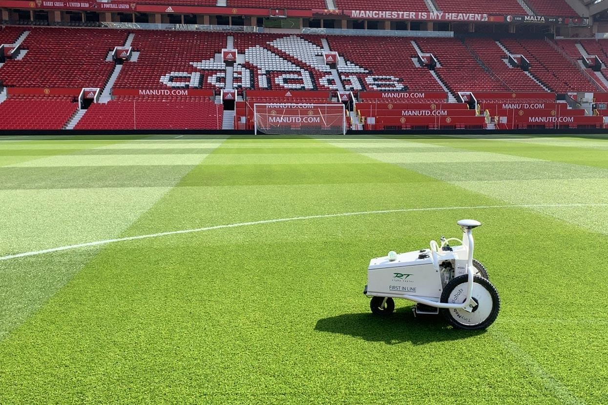Line marking robot painting NHS logo at Old Trafford